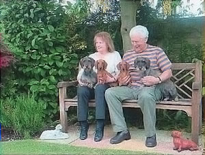 Pat and Maurice with Dog sitting on garden bench